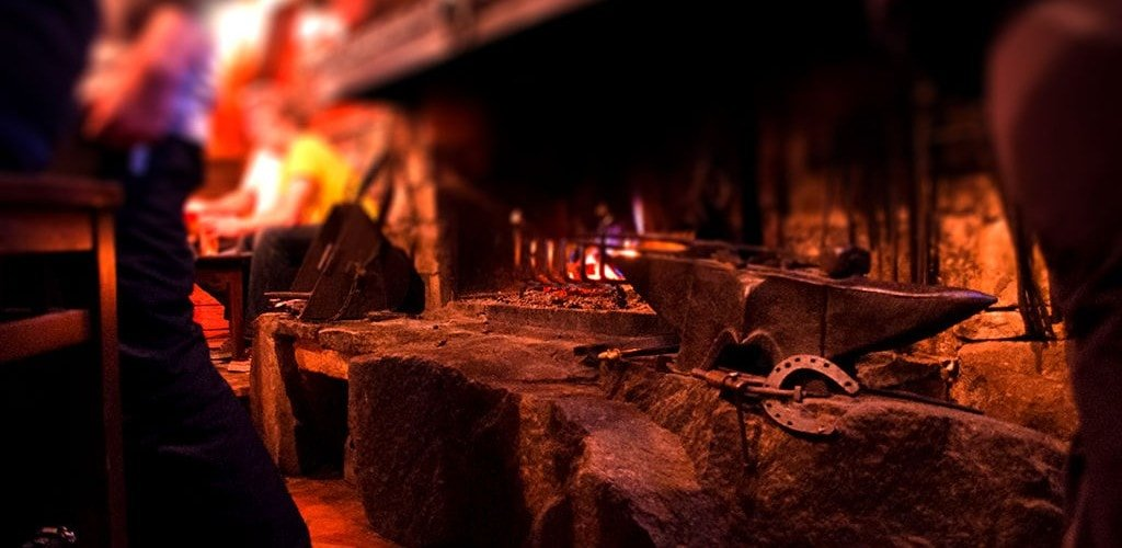 A roaring fire warms Bar La Mine