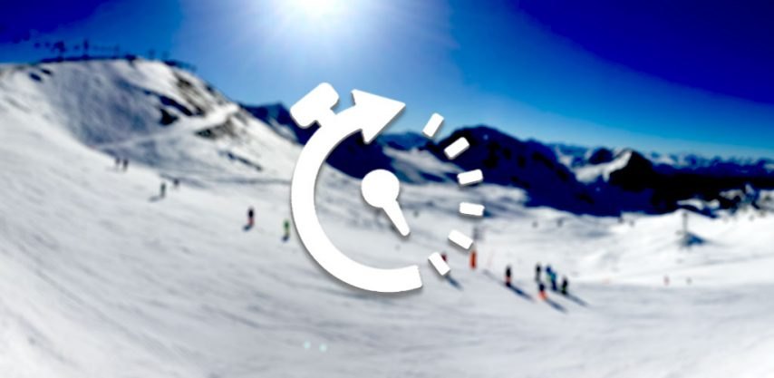 Blurred ski slope scene with time-lapse turner icon overlaid
