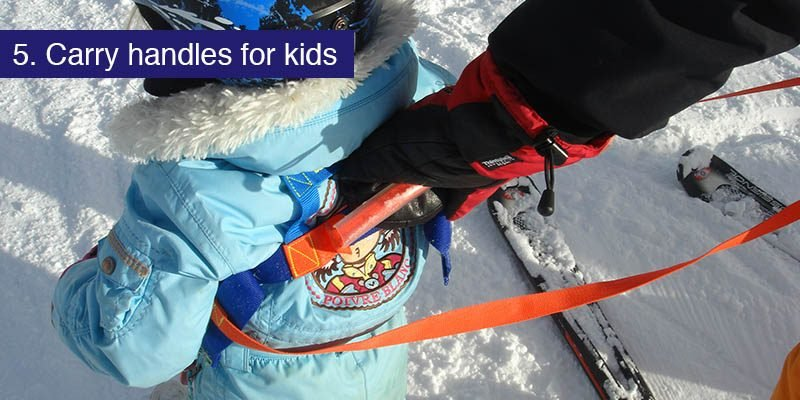 """<h3>Carry handle</h3>Young kids on snow often have a wobble or a slip and it's hard to steady them quickly, after all, what do you grab? Many a toddler has been hoisted up by the hood as they fall over and in an all-in-one suit that gives them a full body wedgie in trade for hitting the ground. Not a trade an adult would want to make.<br><br>The answer is a carry handle for your small children. There are many available known as a <a href=""""https://www.firstaid4sport.co.uk/supports-and-braces-c5/childrens-supports-and-braces-c59/hobbledehoo-active-childs-harness-p617/""""target=""""_blank"""">child harness</a> or our favourite, the <a href=""""https://www.nippergrip.com""""target=""""_blank"""">Nipper grip</a>. A secure harness with a heavy duty carry handle in the lower back means that when your youngster starts to fall, you've got a helpful handle to grab and lift them in a comfortable harness back onto their feet. A carry handle can be just the ticket when out on the slopes or just walking around the resort."""