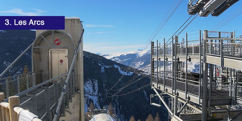 """<h3>Make your way to Les Arcs</h3>Les Arcs is made up of four modern resorts and the village resorts are built in two sectors, Arc 1950 and 2000 in one sector and Arc 1600, 1800 in another which are located lower down. <a href=""""/blog/get-the-most-from-your-paradiski-lift-pass/"""" target=""""_blank"""" rel=""""noopener noreferrer"""">The Paradiski area pass</a> gets you access to all of La Plagne, and Les Arc. The slopes offer long descents and steep slopes to keep the more advanced skiers happy, but for beginners there are plenty of varied slopes, on and off piste.<br></br>It also includes numerous play areas such as freestyle runs, toboggan runs and snow parks. It even has a run where you can discover the local flora and fauna! The impresive cable car, the Vanoise Express takes you back to La Plagne."""