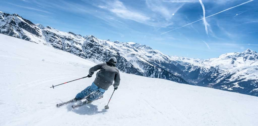 A skilled skier skiing in Tarentaise Valley
