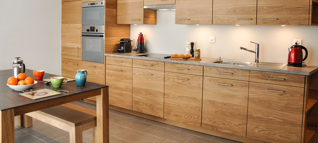 Stylish kitchenette with plenty of storage and facilities