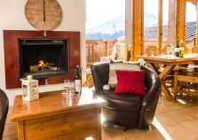 Log fire and leather seats in the Penthouse Chalet lounge