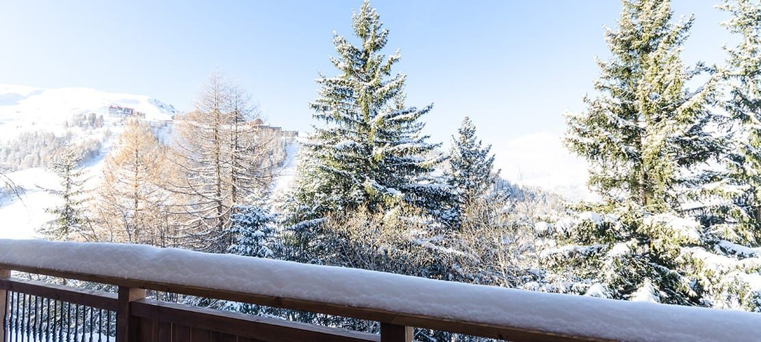 Exterior balcony of chalet Ammonite with views of La Plagne 1800