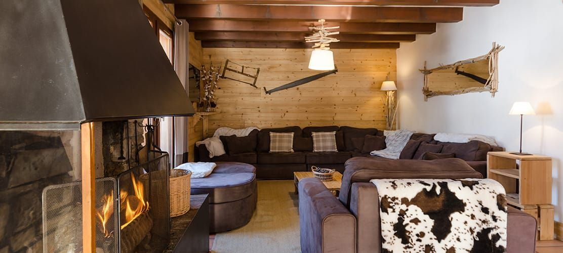 Chalet lounge with sofas and log fire