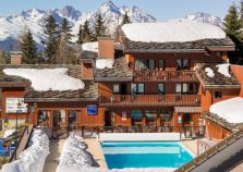 The exterior of Chalet Grand Chardon within a complex with a private swimming