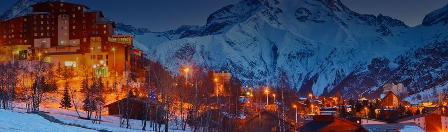 An Alpine ski village in France and night