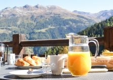 Chalet breakfast with mountain views