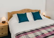 Crisp sheets on a chalet double bed