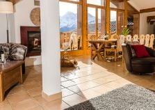 A huge living space in the chalet with full length windows