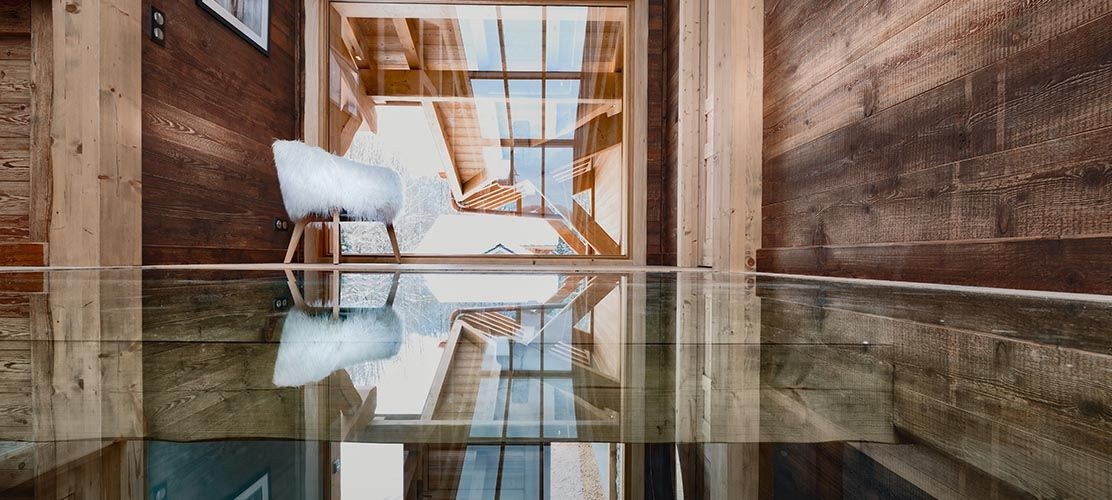Glass floor ski chalet