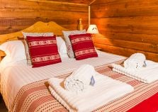 A double bedroom of Chalet Soleil