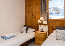 Twin bedroom in chalet Graphite