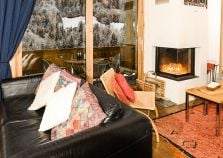 Cosy lounge with roaring fire