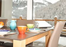 Enjoy breakfast with views over the alpine covered mountains