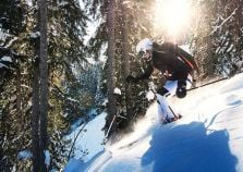 Off piste skiing in the trees by Courchevel Le Praz