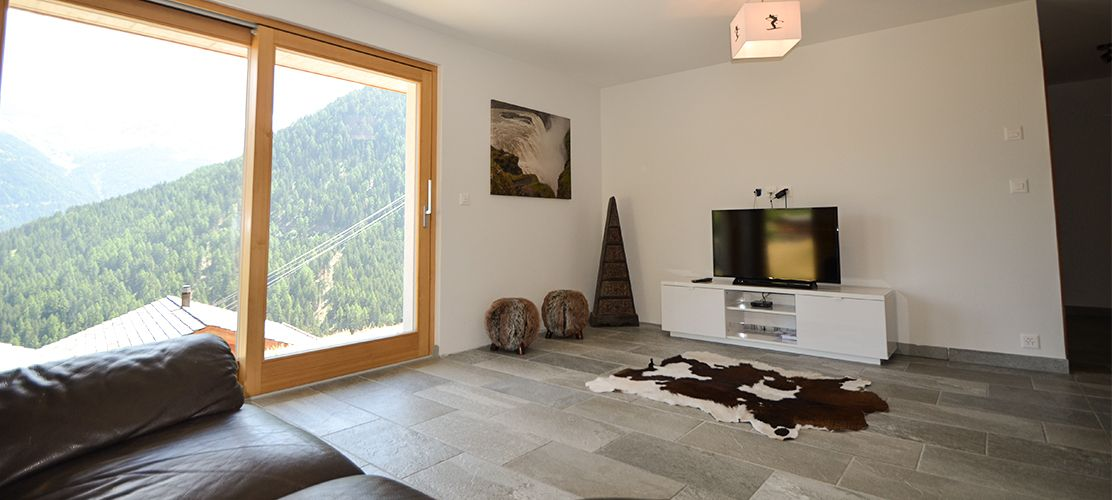 Open plan living area in Chalet Pic Blanc